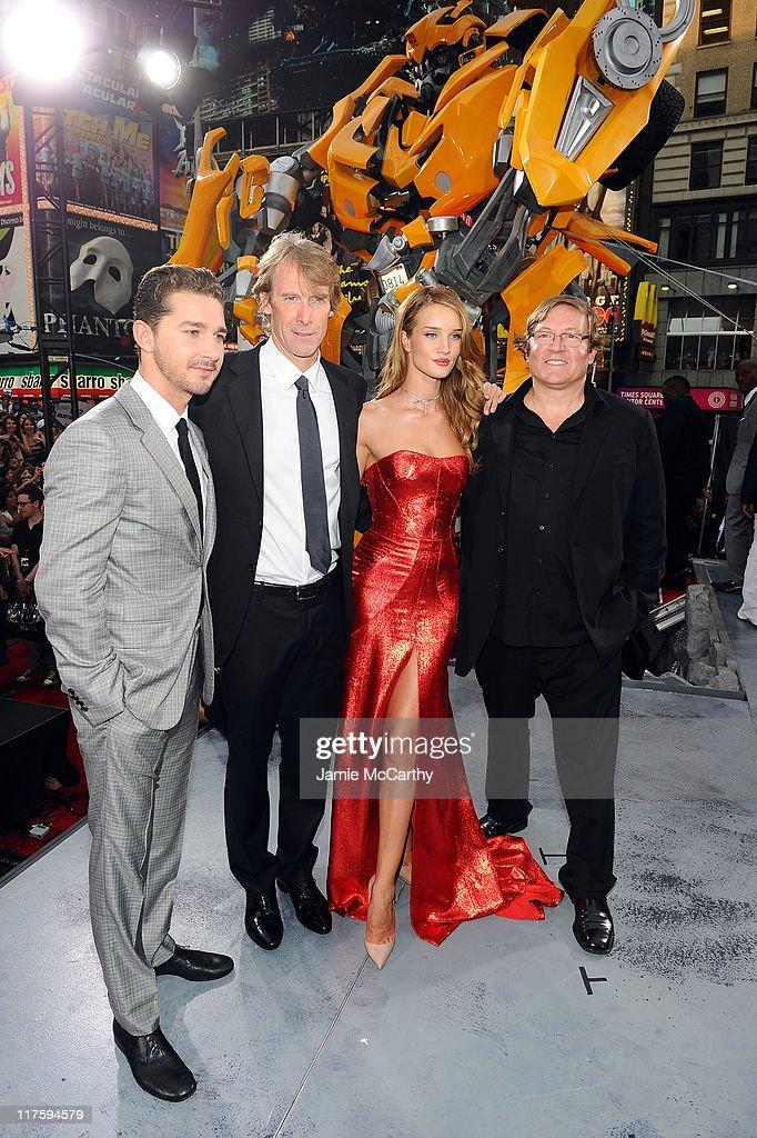 Shia LaBeof Michael Bay Rosie HuntingtonWhiteley and producer Lorenzo di Bonaventura attend the 'Transformers Dark Of The Moon' premiere in Times...