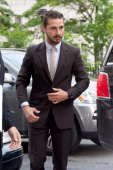 Shia LaBeouf arrives at Manhattan Criminal Court on July 24 2014 in New York City LaBeouf was charged with criminal trespass disorderly conduct and...