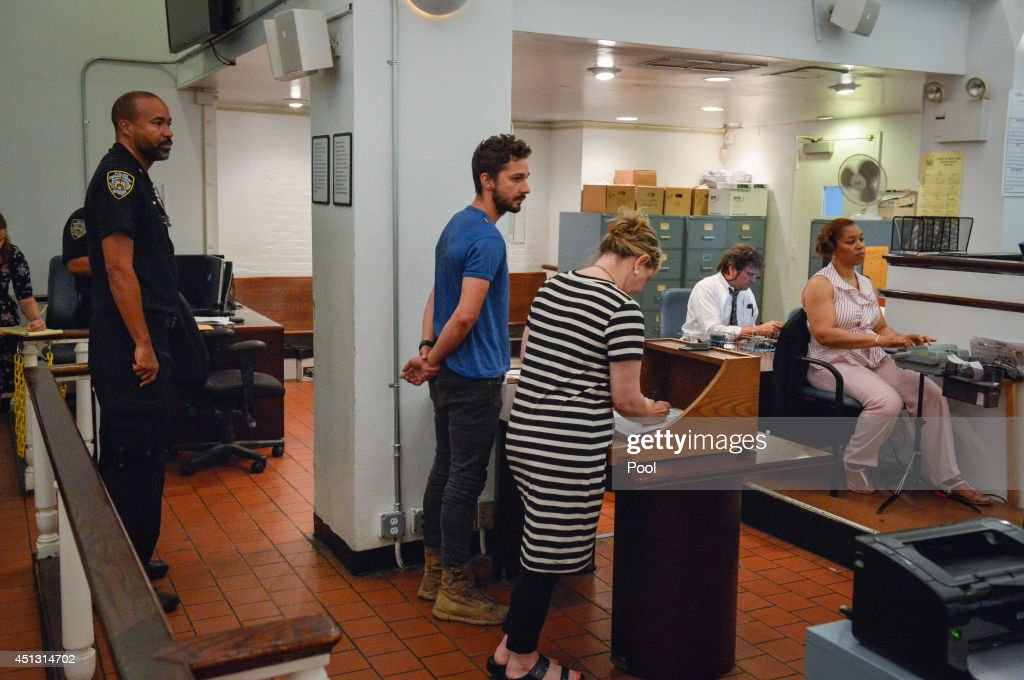 Shia LaBeouf (C), is arraigned in Midtown Community Court, on June 27, 2014 in New York City. The actor is charged with harrassment, disorderly conduct and criminal trespass following an incident during the show' 'Cabaret' Thursday night.
