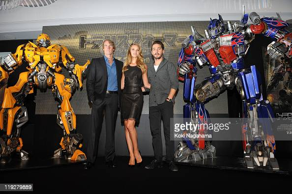 Shia LaBeouf Michael Bay and Rosie HuntingtonWhiteley attend the 'Transformers Dark of the Moon' stage greeting at Osaka Station City Cinema on July...