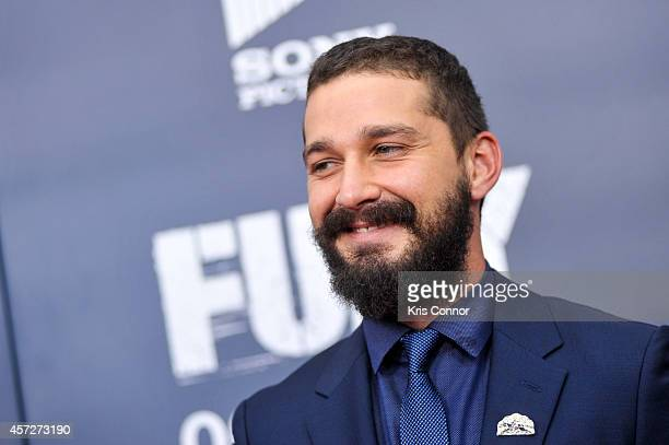 Shia LaBeouf poses for photographers on the red carpet during the 'The Fury' Washington DC premiere at The Newseum on October 15 2014 in Washington DC