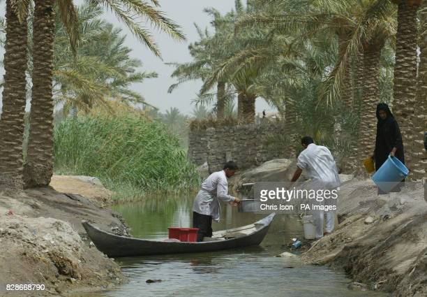 Shia marsh arabs return to their homes near Al Qurna Iraq with vessels full of fresh water Looters raided the nearby purification plant where water...