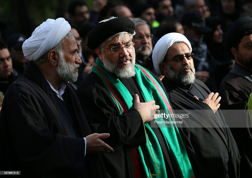 Shia Muslim clerics take part in an Ashura day mourning procession on November 14, 2013 in London, England. Ashura is a day of solemn mourning for the martyrdom of Hussein in 680 AD.