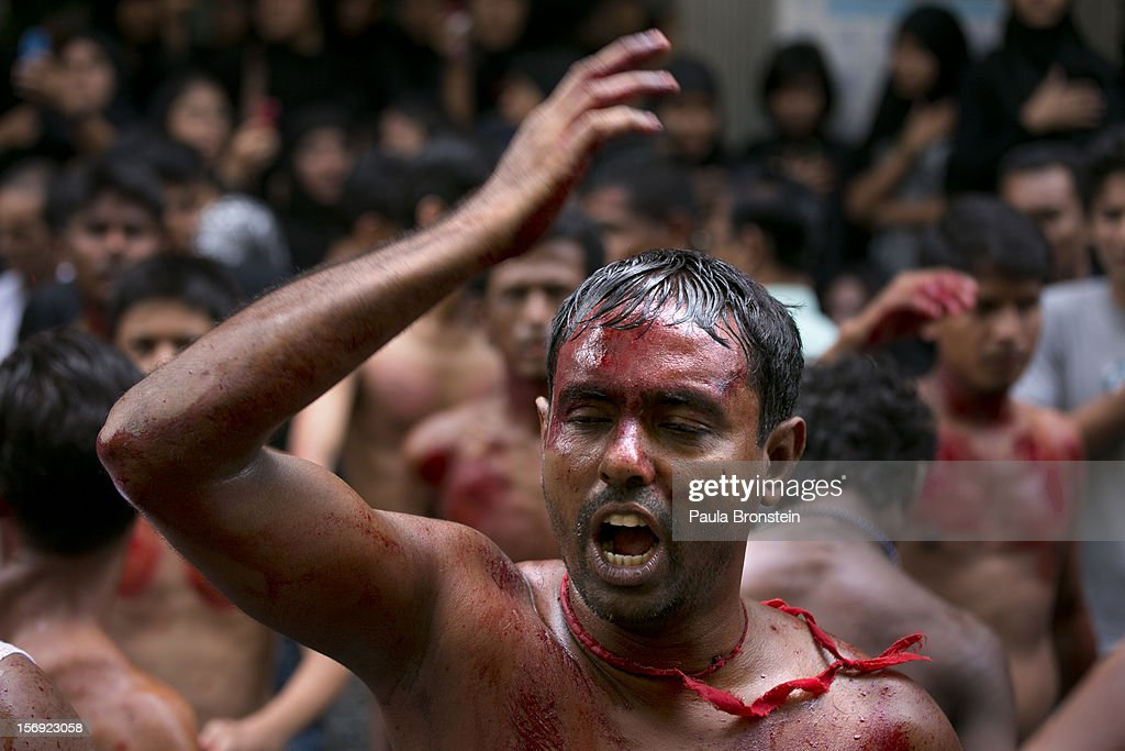 Shia muslims mark the Day of Ashura, striking themselves till they are bloody with razors and chains on November 25, 2012 in Yangon, Myanmar. The day of Ashura is a national holiday held on the 10th day of Muharram in the Islamic calendar, with men beating themselves as they mourn the martyrdom of Husayn ibn Ali, the grandson of the Islamic Prophet Muhammad. In Myanmar there are approximately 20,000 Shia muslims.
