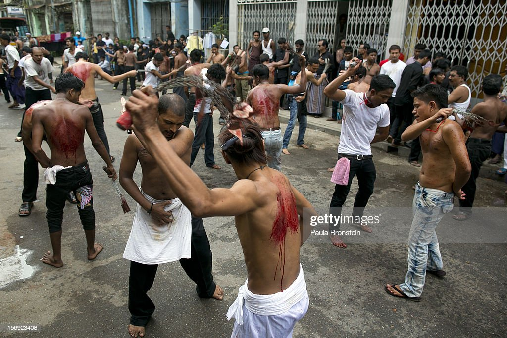 Shia muslims mark the Day of Ashura, striking themselves till they are bloody with razors and chains on November 25, 2012 in Yangon, Myanmar. The day of Ashura is a national holiday held on the 10th day of Muharram in the Islamic calendar, with men beating themselves as they mourn the martyrdom of Husayn ibn Ali, the grandson of the Islamic Prophet Muhammad. There are approximately 20,000 Shia muslims in Myanmar.