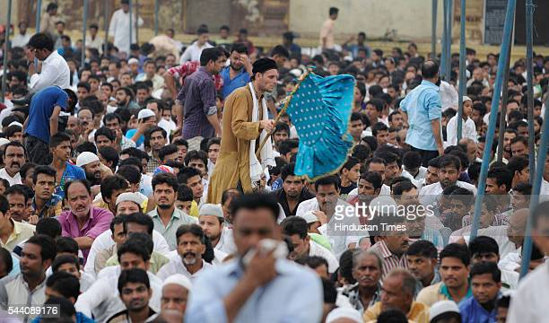 Shia muslims sitting in a row to offer Alvida Namaj at Ashfi Masjid at Bara Imambara on July 1 2016 in Lucknow India EidUlFitr will be observed in...