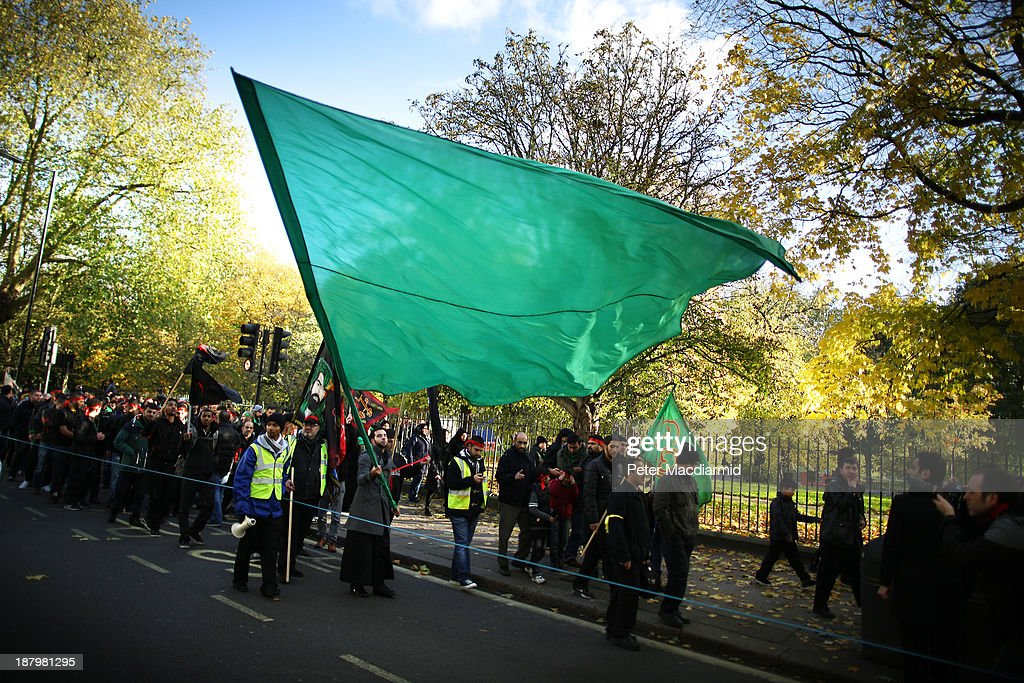 Shia Muslims take part in an Ashura day mourning procession on November 14, 2013 in London, England. Ashura is a day of solemn mourning for the martyrdom of Hussein in 680 AD.