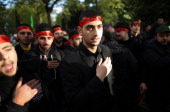 Shia Muslims take part in an Ashura day mourning procession on November 14 2013 in London England Ashura is a day of solemn mourning for the...