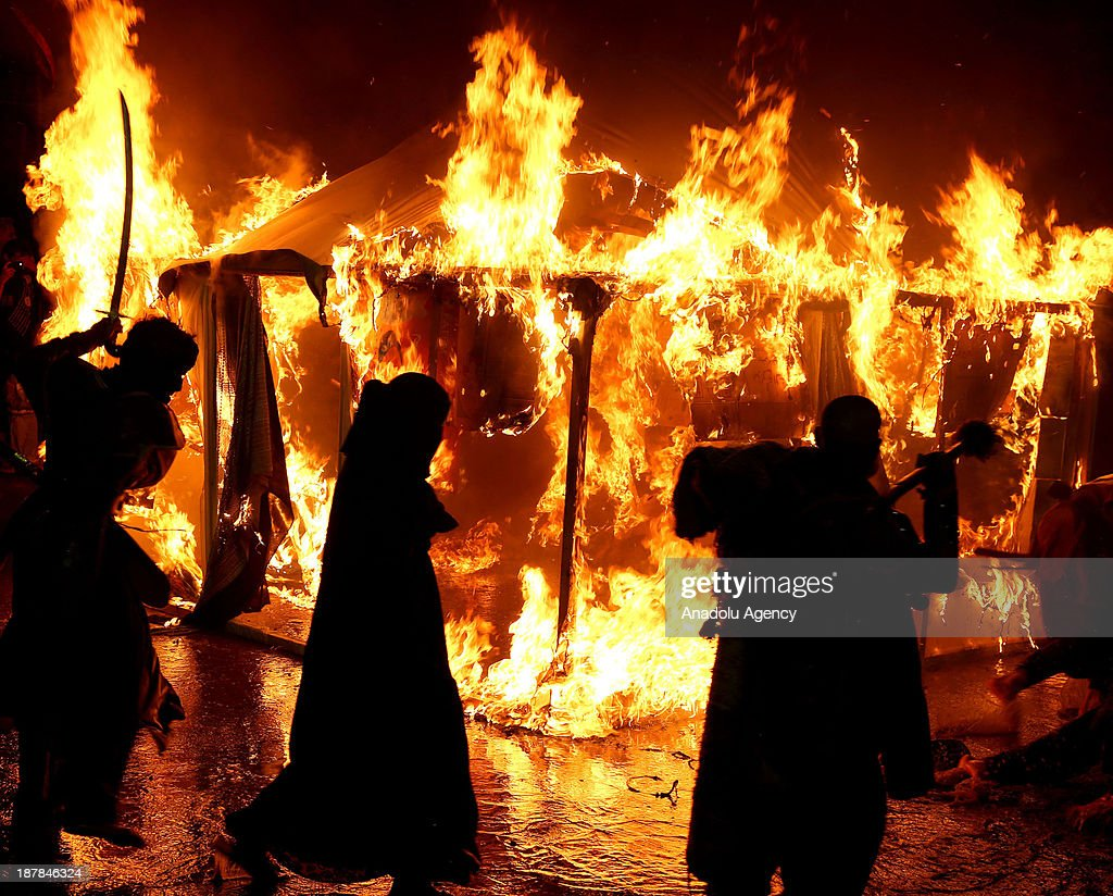 Shia Muslims turn around a burning tent according to a ritual ceremony of the Ashura Day on November 13, 2013 in Karbala, Iraq. Muslims to celebrate the day of Ashura which is the tenth day of Muharram (the first month of the Islamic calendar), mourning the seven-century martyrdom of Prophet Mohammad's grandson Prophet Hussein (Husayn ibn Ali) who was killed in Battle of Karbala in Iraq 680 AD.