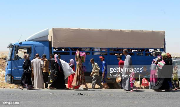 Shia Turkmens flee from Sincar to Arbil due to attacks of army groups led by Islamic State in Arbil Iraq on 18 July 2014 Turkmens wait on Hazar point...