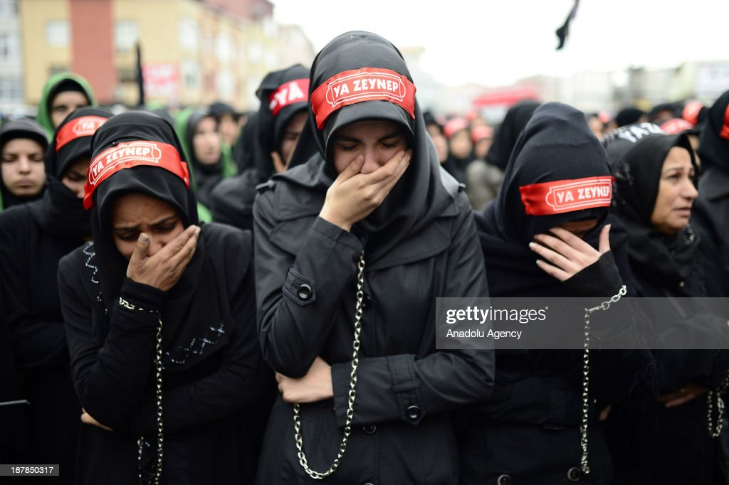 Shia women mourn as they enchain themselves through the universal Ashura Day that is held at Halkali Arena Park on November 13, 2013 in Istanbul, Turkey. Ashura day is well-known because of mourning for the martyrdom of Husayn ibn Ali, the second grandson of Muhammad, who was killed during the Battle of Karbala in 680.