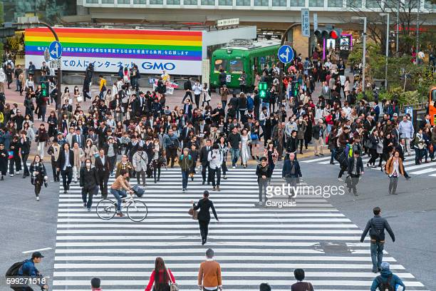 Shibuya crossing, pedestrians and cyclist crossing the road, street level
