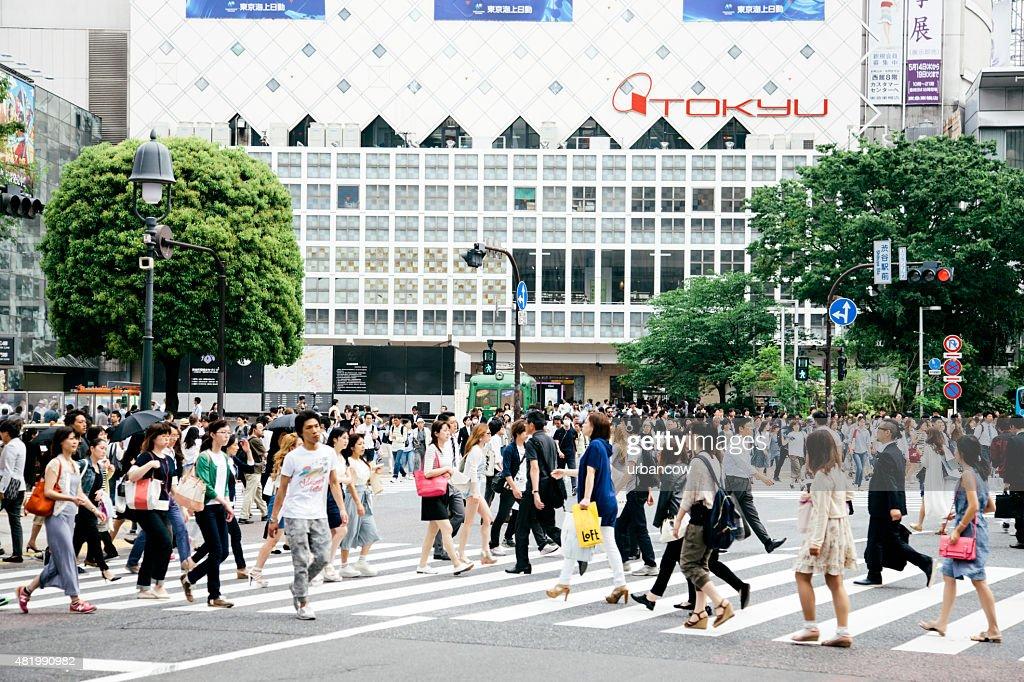Shibuya crossing, pedestrians crossing the road, street level