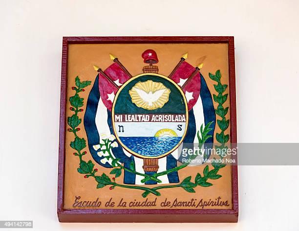 Shield of the city of Sancti Spiritus' on a wooden box frame at the Guayabera Museum Sancti Spiritus Cuba