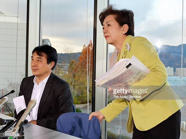 Shiga Prefecture governor Yukiko Kada leaves a conference room after announcing a new antinuclear party 'Nippon Mirai no To ' on November 27 2012 in...