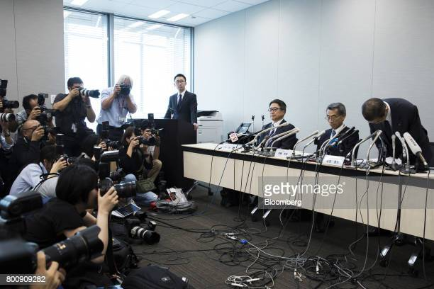 Shigehisa Takada chairman and chief executive officer of Takata Corp right bows during a news conference in Tokyo Japan on Monday June 26 2017 Takata...