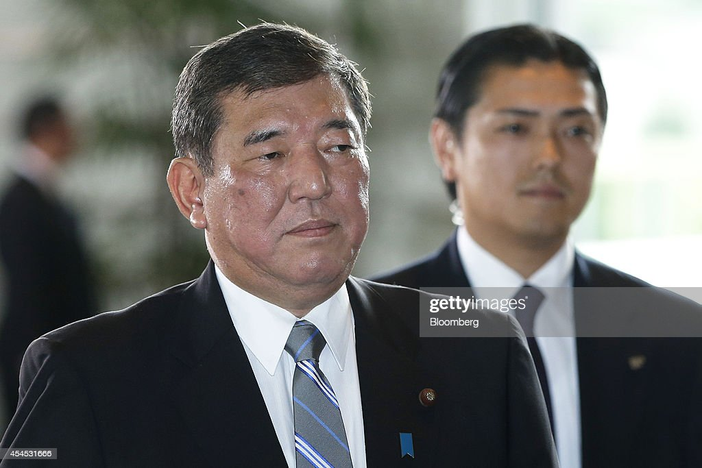 <a gi-track='captionPersonalityLinkClicked' href=/galleries/search?phrase=Shigeru+Ishiba&family=editorial&specificpeople=2921096 ng-click='$event.stopPropagation()'>Shigeru Ishiba</a>, Japan's newly appointed minister in charge of regional economy, arrives at the prime minister's official residence in Tokyo, Japan, on Wednesday, Sept. 3, 2014. Japanese Prime Minister Shinzo Abe placed an advocate of pro-market reforms in charge of the government pension fund and named a rising female politician as industry minister as he seeks to restore momentum to his Abenomics policies with a cabinet reshuffle today. Photographer: Kiyoshi Ota/Bloomberg via Getty Images