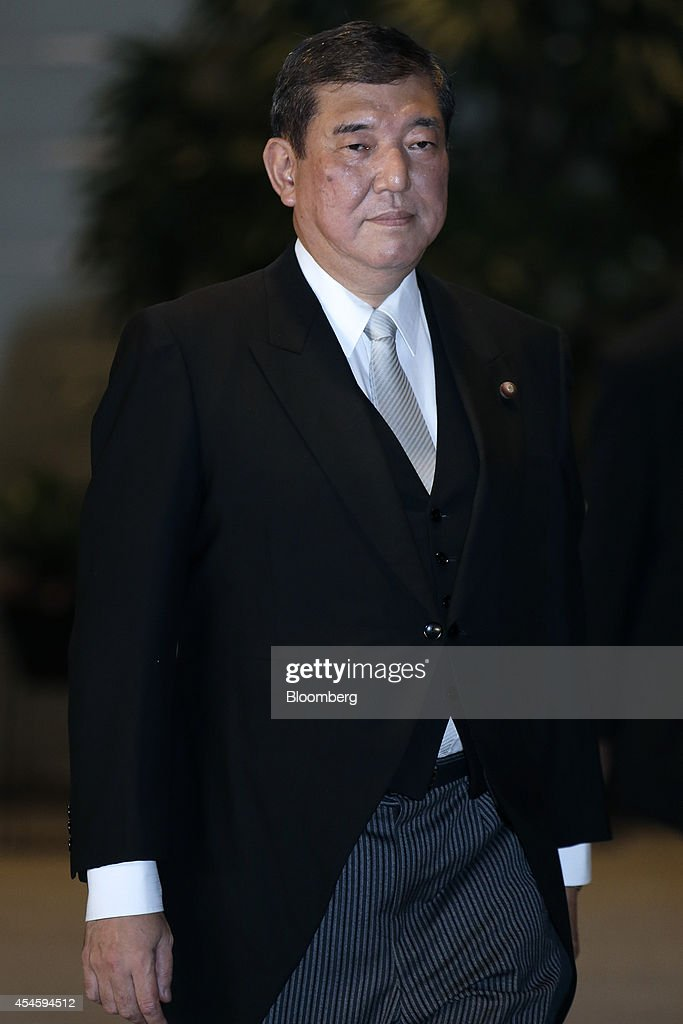 <a gi-track='captionPersonalityLinkClicked' href=/galleries/search?phrase=Shigeru+Ishiba&family=editorial&specificpeople=2921096 ng-click='$event.stopPropagation()'>Shigeru Ishiba</a>, Japan's newly appointed minister in charge of regional economy, arrives at the prime minister's official residence after the attestation ceremony at the Imperial Palace in Tokyo, Japan, on Wednesday, Sept. 3, 2014. Japanese Prime Minister Shinzo Abe placed an advocate of pro-market reforms in charge of the government pension fund and named a rising female politician as industry minister as he seeks to restore momentum to his 'Abenomics' policies with a cabinet reshuffle today. Photographer: Kiyoshi Ota/Bloomberg via Getty Images