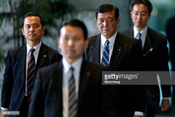 Shigeru Ishiba Japan's reappointed minister in charge of regional economy second from right arrives at the prime minister's official residence in...