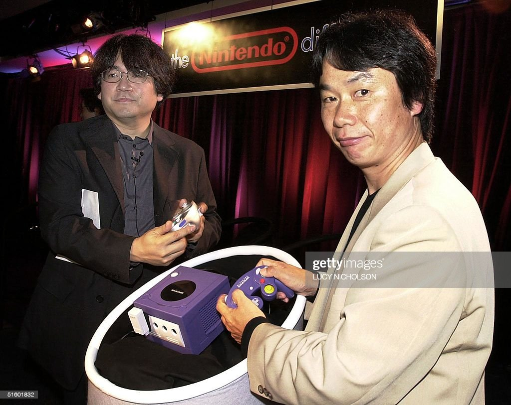 <a gi-track='captionPersonalityLinkClicked' href=/galleries/search?phrase=Shigeru+Miyamoto&family=editorial&specificpeople=2608501 ng-click='$event.stopPropagation()'>Shigeru Miyamoto</a> (R), legendary Japanese game designer and Director of Nintendo Co., Ltd., demonstrates the controls of the company's latest 128-bit machine, the GameCube with Director of Nintendo Corporate Planning <a gi-track='captionPersonalityLinkClicked' href=/galleries/search?phrase=Satoru+Iwata+-+Businessman&family=editorial&specificpeople=815873 ng-click='$event.stopPropagation()'>Satoru Iwata</a> (L) during a media preview in Los Angeles 16 May 2001. AFP PHOTO/Lucy NICHOLSON