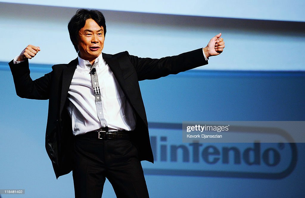 <a gi-track='captionPersonalityLinkClicked' href=/galleries/search?phrase=Shigeru+Miyamoto&family=editorial&specificpeople=2608501 ng-click='$event.stopPropagation()'>Shigeru Miyamoto</a>, Senior Managing Director, Nintendo Co., Ltd., speaks during a news conference as an orchestra performs before the unveiling of the new game console Wii U at the Electronic Entertainment Expo on June 7, 2011 in Los Angeles, California. The Wii U will have HD graphics, a controller with a 6.2 inch touchscreen and be compatible with all other Wii accessories.