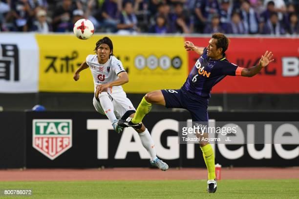 Shigeru Yokotani of Omiya Ardija and Toshihiro Aoyama of Sanfrecce Hiroshima compete for the ball during the JLeague J1 match between Sanfrecce...