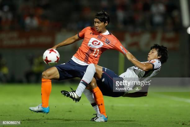 Shigeru Yokotani of Omiya Ardija and Yuichi Maruyama of FC Tokyo compete for the ball during the JLeague J1 match between Omiya Ardija and FC Tokyo...