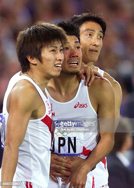 Shigeyuki Kojima Shingo Suetsugu and Nobuhiro Asahara of Japan react after competing in the Men's 4x100m final during the Sydney Olympics at Stadium...