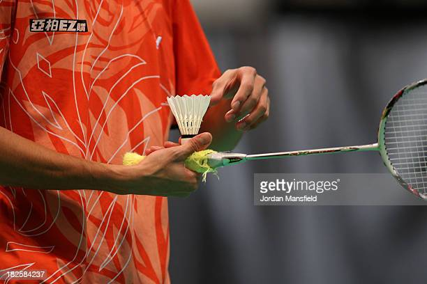 Shih Kuei Chun of Chinese Taipei straightens the feathers on a shuttlecock during Day One of the London Badminton Grand Prix at The Copper Box on...