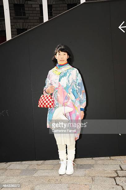 Shiho Ichinose freelance travel writer wearing a silk coat and dress with attached polar bear by Christopher Raeburn leggings and leg warmers by...