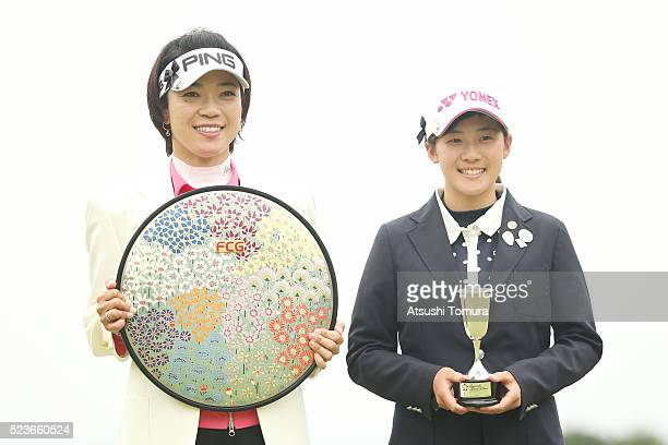 Shiho Oyama of Japan and Suzuka Yamaguchi of Japan pose with trophy after the Fujisankei Ladies Classic at the Kawana Hotel Golf Course Fuji Course...