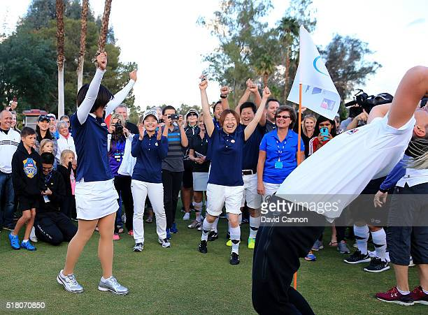 Shiho Oyama of Japan Ayako Uehara of Japan and Yayoi Kobayashi of Japan football team celebrate as they sealed victroy as Abby Wambach of the United...