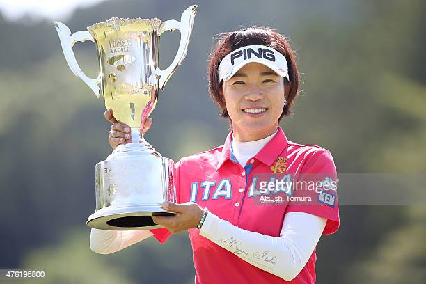 Shiho Oyama of Japan poses with the trophy after winning the Yonex Ladies Golf Tournament 2015 at the Yonex Country Club on June 7 2015 in Nagaoka...