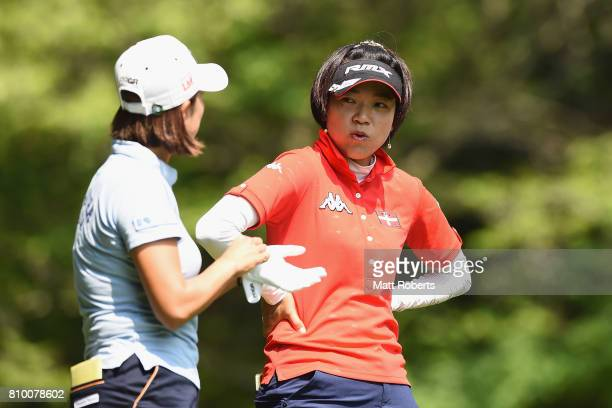 Shiho Oyama of Japan speaks with Erina Hara of Japan during the first round of the Nipponham Ladies Classics at the Ambix Hakodate Club on July 7...