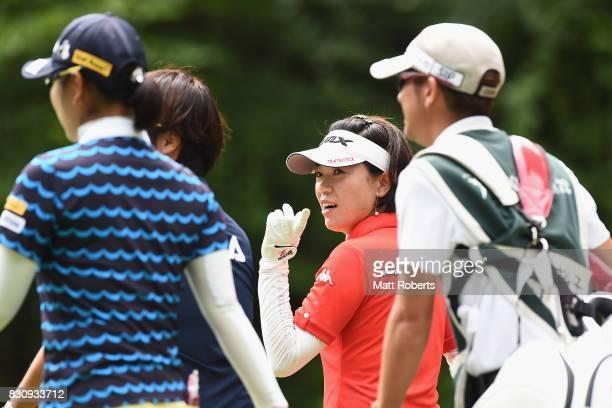Shiho Oyama of Japan speaks with Saiki Fujita and Yuko Fukuda of Japan during the final round of the NEC Karuizawa 72 Golf Tournament 2017 at the...