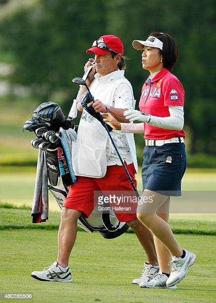 Shiho Oyama of Japan walks with her caddie Dana Derouaux on the ninth hole during the second round of the US Women's Open at Lancaster Country Club...