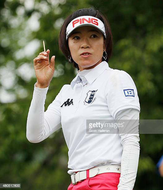 Shiho Oyama of Japan waves to the gallery on the second hole during the final round of the US Women's Open at Lancaster Country Club on July 12 2015...