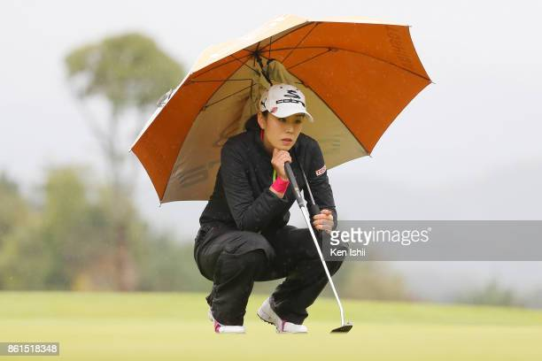 Shiho Toyonaga of Japan lines up for a putt on the 18th hole during the final round of the Udonken Ladies at the Mannou Hills Country Club on October...