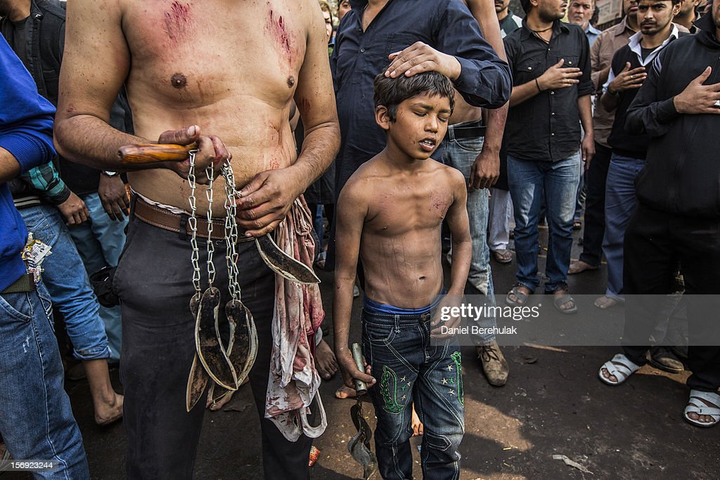 A Shiite boy rests after having self-flagellated during a religious procession marking Ashura on November 25, 2012 in New Delhi, India. The religious festival of Ashura, which involves a ten-day mourning period starting with the first day of Muharram on the Islamic calendar, commemorates and mourns the seventh-century martyrdom of Prophet Muhammad's grandson Imam Hussein in the battle of Karbala.