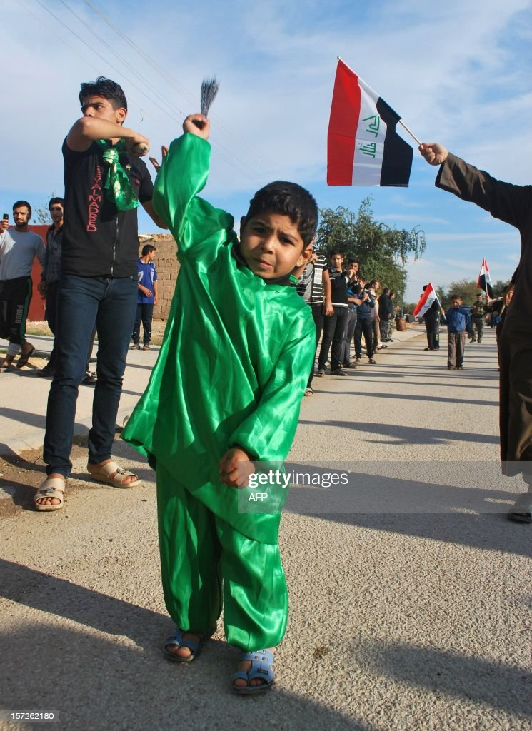 Shiite boy takes part in a march to mark Ashura in the Iraqi town of Baghdadi, in the Anbar province, on November 30, 2012. The march saw the participation of Sunni Muslim clerics from the province, which was long associated with Islamic fundementalist groups. AFP PHOTO / AZHAR SHALLAL