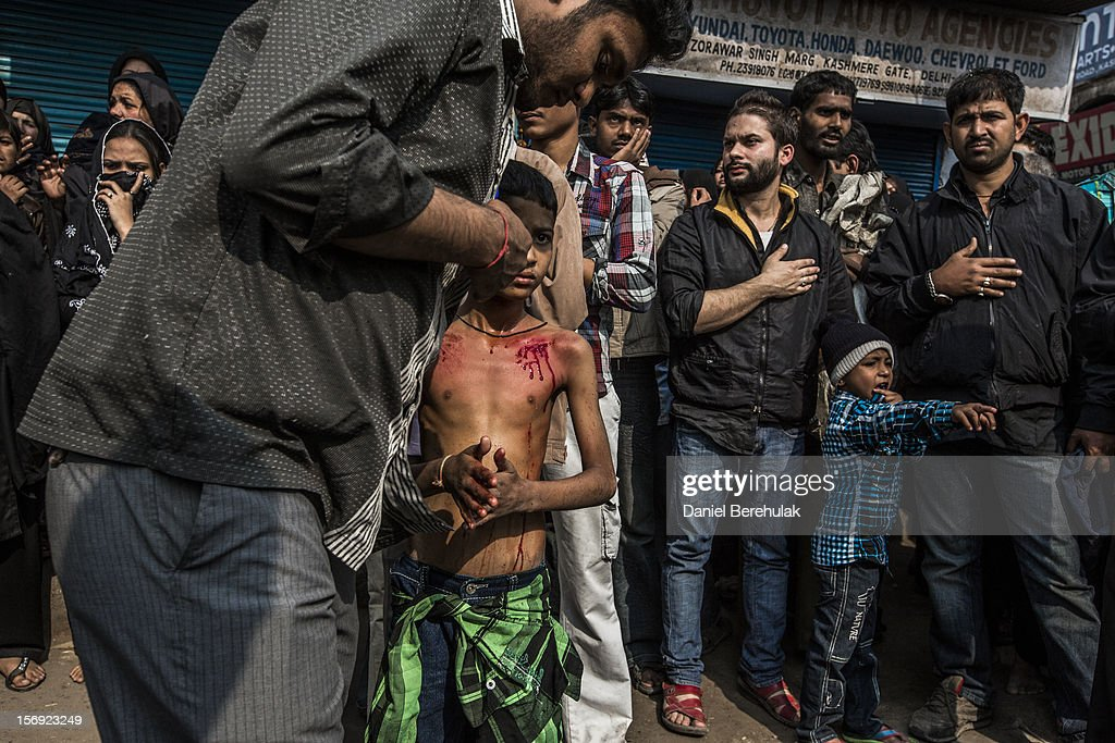A Shiite boy takes part in a self-flagellation ritual during a religious procession marking Ashura on November 25, 2012 in New Delhi, India. The religious festival of Ashura, which involves a ten-day mourning period starting with the first day of Muharram on the Islamic calendar, commemorates and mourns the seventh-century martyrdom of Prophet Muhammad's grandson Imam Hussein in the battle of Karbala.