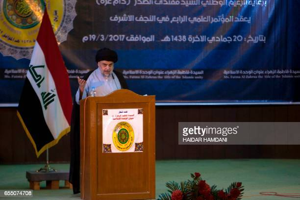 Shiite cleric Moqtada alSadr delivers a speech during a gathering in the Iraqi holy city of Najaf on March 19 2017 / AFP PHOTO / Haidar HAMDANI