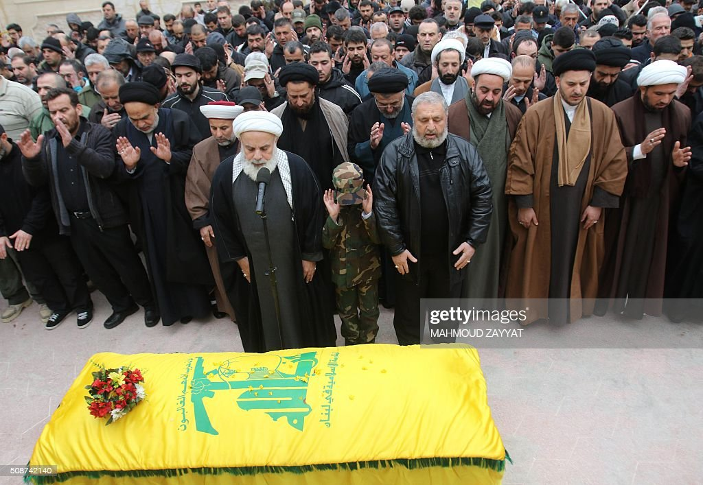 Shiite clerics and mourners attend the funeral of Ali Ahmed Sabra, a member of Lebanon's militant Shiite Muslim movement Hezbollah who was killed in combat alongside Syrian government forces in Aleppo, on February 6, 2016, in the Lebanese village of Jibshit, about 50 kilometres south of the capital Beirut. / AFP / MAHMOUD ZAYYAT