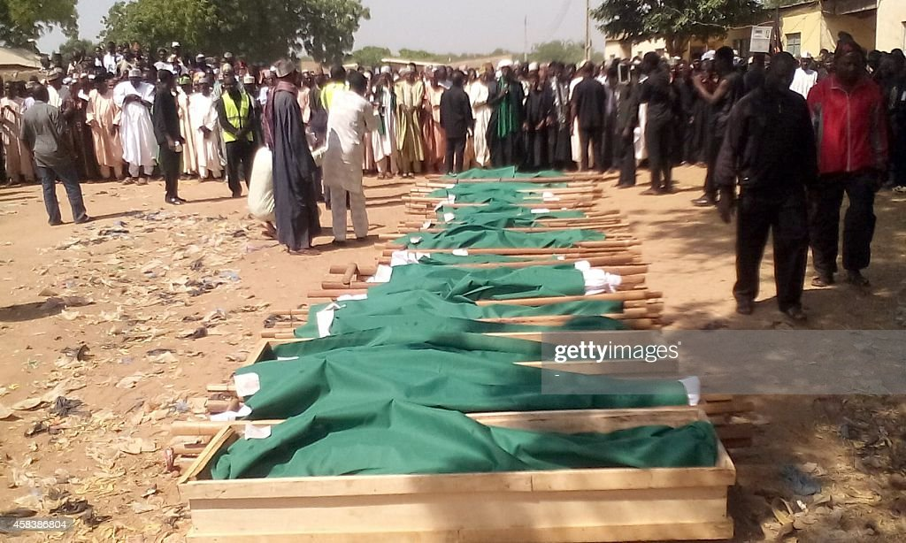 Shiite community members gather on November 4 2014 for funeral rites of members killed on November 3 during a procession at a Shiite festival in...