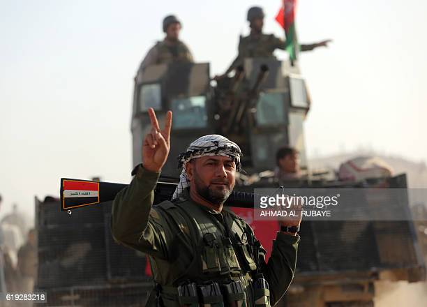 TOPSHOT Shiite fighters from the Hashed alShaabi advance towards the village of Salmani south of Mosul on October 30 2016 during the ongoing battle...