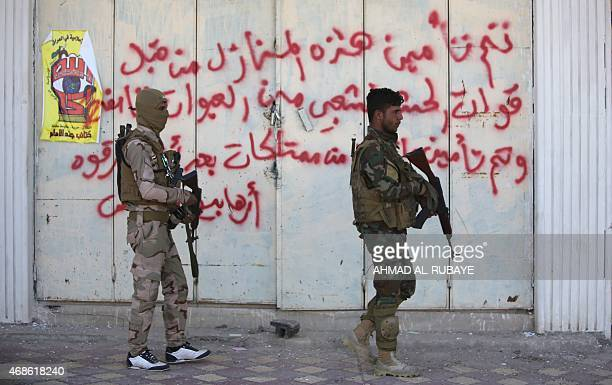 Shiite fighters from the Popular Mobilisation units patrol the streets in Tikrit on April 4 2015 after a statement by Prime Minister Haider alAbadi...