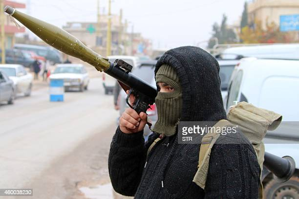 A Shiite gunman holds an rocketpropelled grenade as they block vehicles on a road in the village of Bazzaliyeh which leads the eastern Lebanese town...