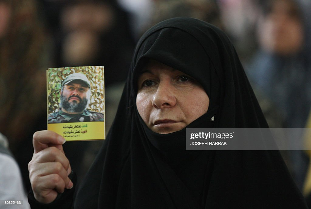 A Shiite Lebanese woman holds up a portrait of slain senior Hezbollah commander Imad Mughnieh during during a rally held in the southern suburbs of...