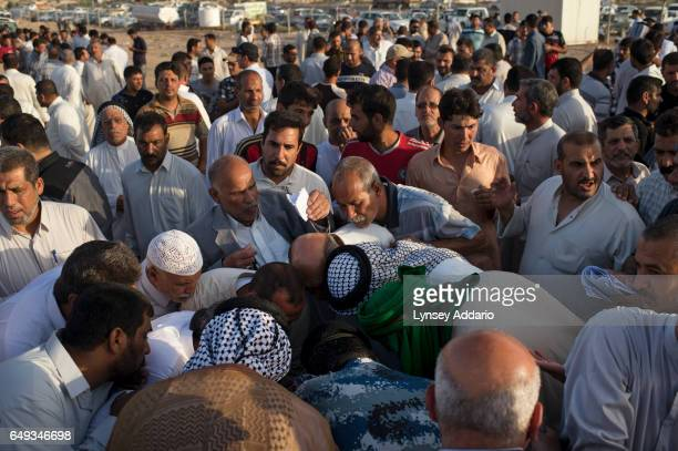 Shiite men and supporters of Grand Ayatollah Ali alSistani line up to register to fight against ISIS at a gathering in Najaf Southern Iraq June 22...