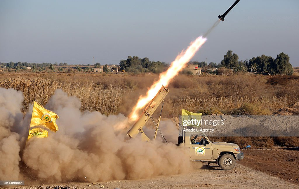 Shiite militia and Iraqi army members continue to clash with Islamic State of Iraq and the Levant in Nebai northern of Baghdad Iraq on January 13...